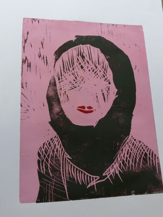 Frauenkopf mit Kopftuch